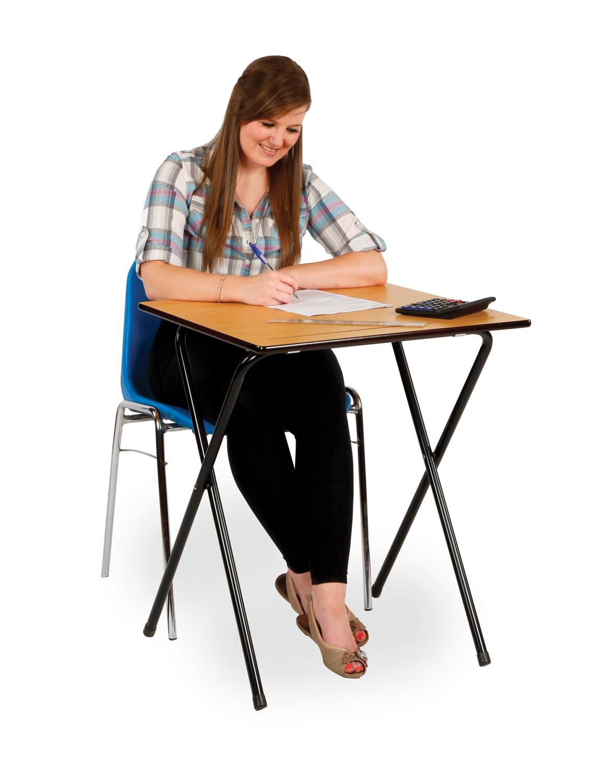 Person_sat_at_exam_desk